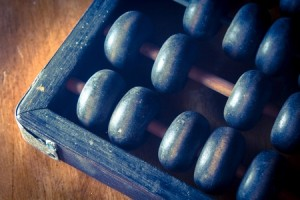 Outsourcing payroll service beats old fasioned accounting, like an abacus.
